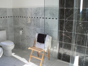 with black and white marble tiles and plenty of space.