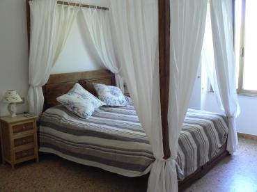 "Romantic ""colonial style"" master bedroom with four poster bed."
